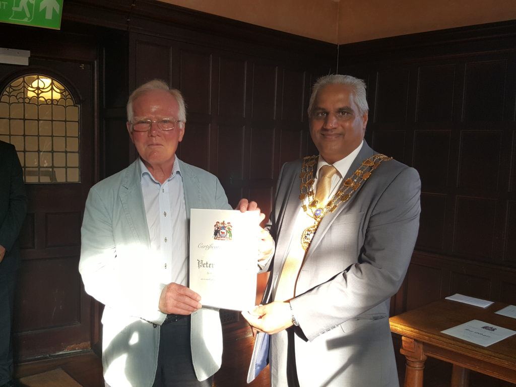 Peter receiving his Certificate of Honour from Cllr Altaf Khan, Sheriff of Oxford