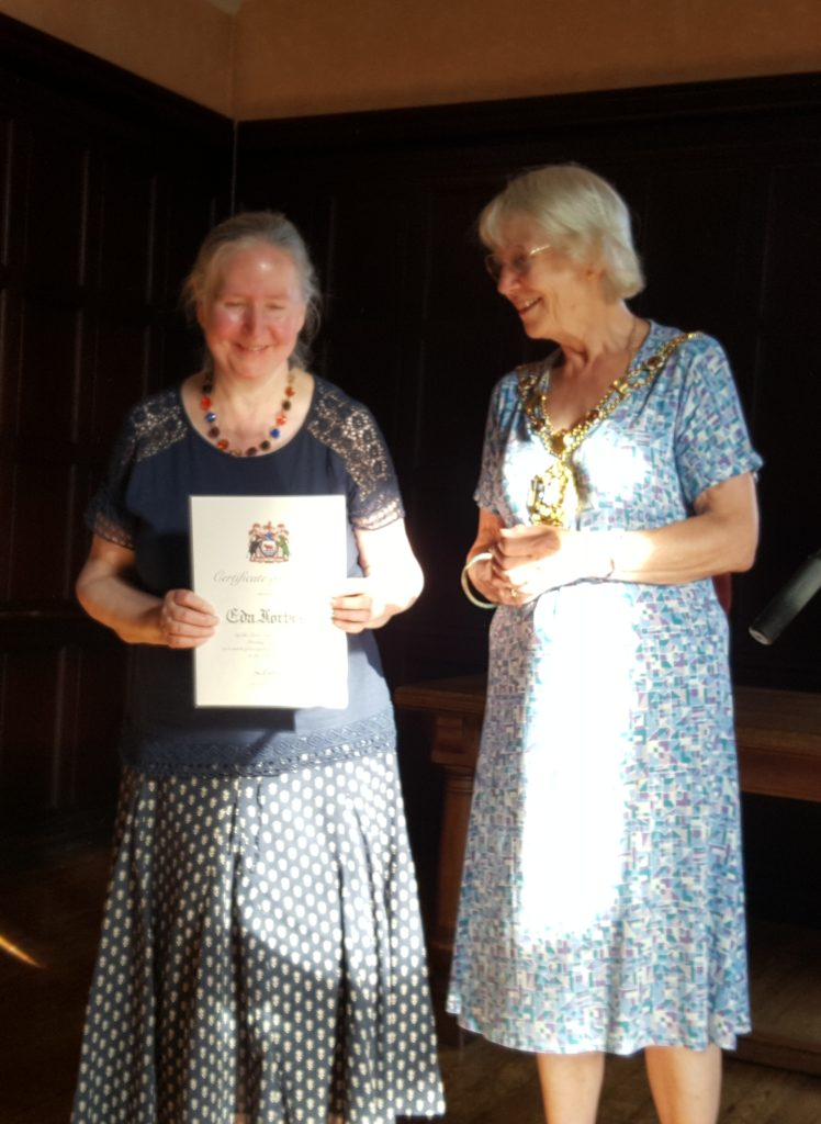 Eda receiving her award from Lord Mayor Jean Fooks